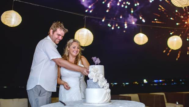 Fireworks go off as the couple cuts the cake.