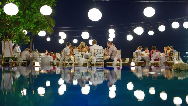 The reception was held by the pool.