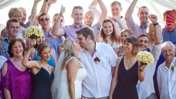 Family and friends celebrate with the newlyweds.