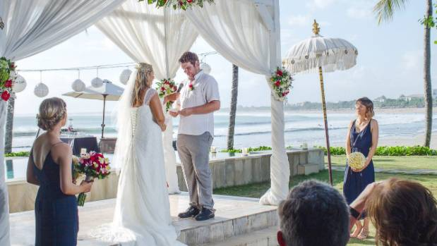 The ceremony took place just before sunset on the lawn overlooking the beach.