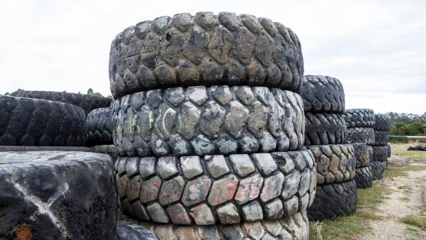 Huge tyres from mining vehicles are among those left on council land in Kawerau by the Merries.