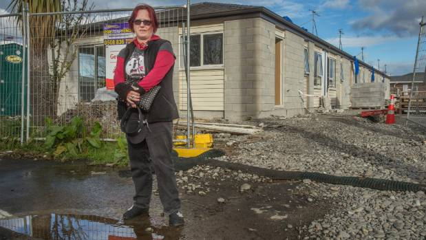Maria Hayward owns one of five units in a multi-unit building being rebuilt by insurers.