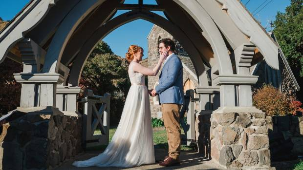 The couple standing in front of St Kentigern's Anglican Church.