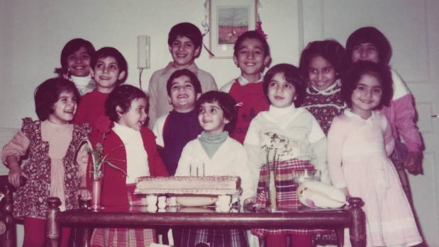 Golriz, centre, celebrates a childhood birthday with cousins and friends, at the house her parents built in Masshad, ...