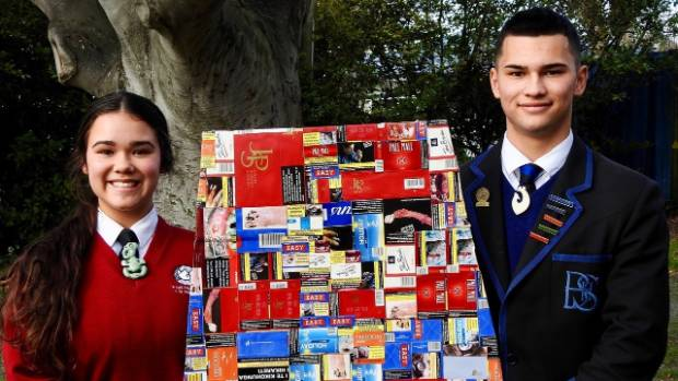 Siblings Brigham (16) and Mei Riwai-Couch (14) with a life-size coffin made out of cigarette boxes. The pair talked ...
