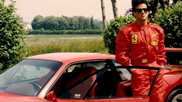 Sylvester Stallone stands alongside a Ferrari F40.