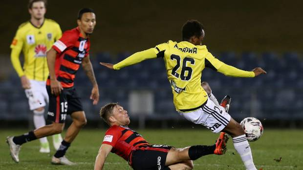 Tinashe Marowa is challenged by Jacob Melling during the FFA Cup round of 32 match between the Wellington Phoenix and ...