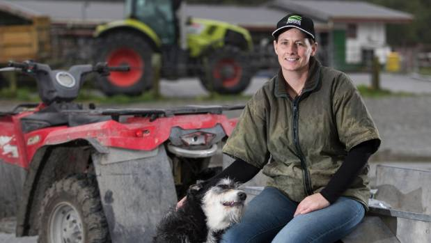 New Federated Farmers president Katie Milne with dog George on her dairy farm near Lake Brunner on the West Coast.