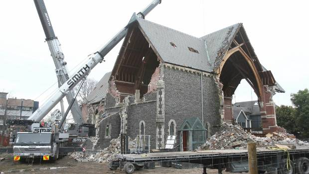 The earthquake-damaged St Luke's church comes down in 2011.