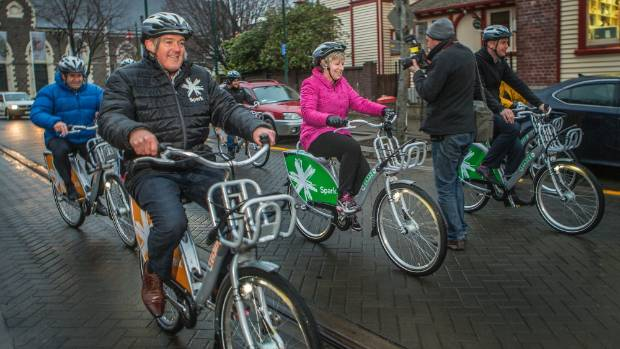 Promoting bike share: Mayor Lianne Dalziel (centre) on one of the new Spark bikes at their 2015 launch.