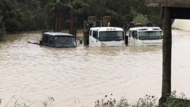Trucks were partly submerged in floods on Tahi Road in March.