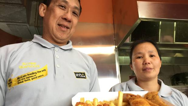 Husband and wife Anthony Cho and Jian Huan Zhou with a serving of the award-winning So Fine Seafoods' fish and chips.