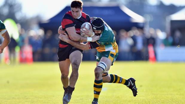 Canterbury wing Josh McKay is tackled by Mid Canterbury lock Angus Lindsay during the Ranfurly Shield challenge in ...