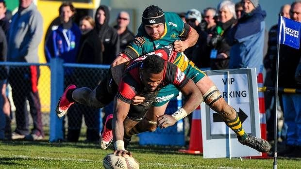 Canterbury centre Poasa Waqanibau dives over for a try against Mid Canterbury in Ashburton on Friday.
