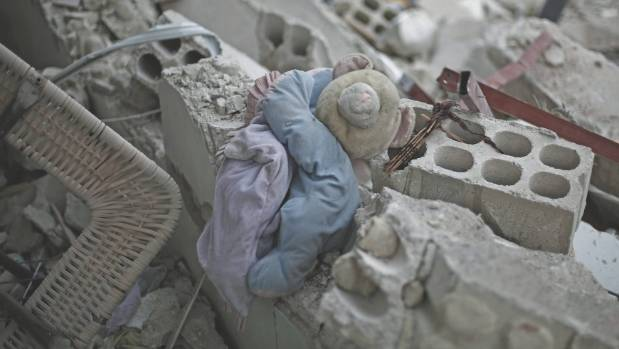 A child's plush toy lies in the rubble of a destroyed building in East Ghouta, rural Damascus.