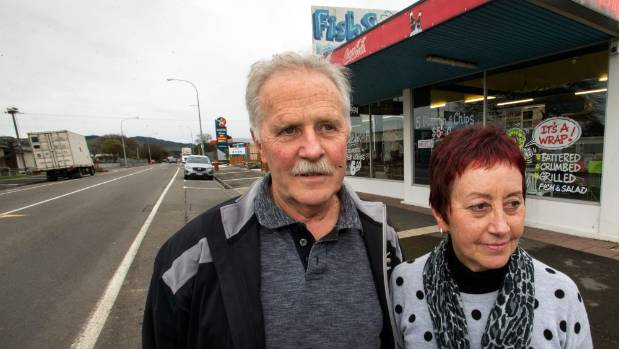 Fishspot owner/operators John Gooding and Judy Thomson of Woodville next to the road that used to provide their livelihood.
