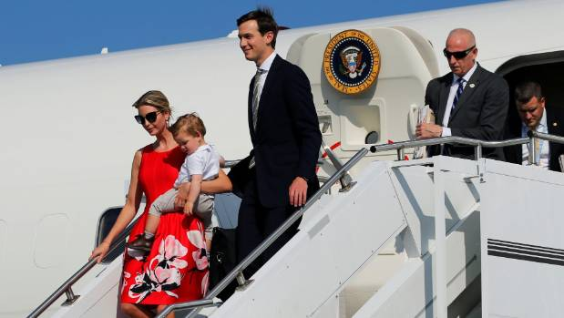 White House senior advisors Ivanka Trump, holding her youngest child Theodore, and Jared Kushner  arrive aboard Air Force On.