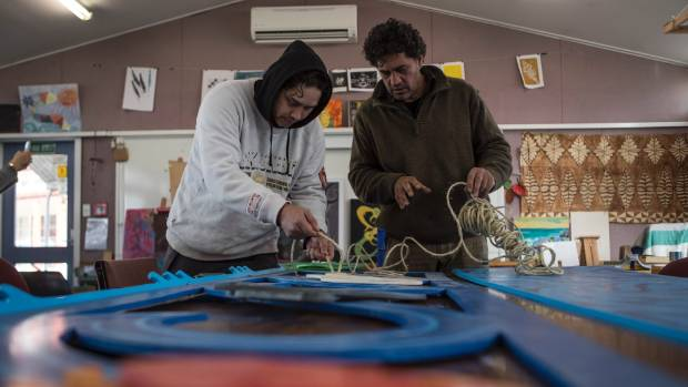 Wood carving teacher Caine Tauwhare helps Gary Pickering with a project to build a waharoa, or gateway, for Otautahi's ...