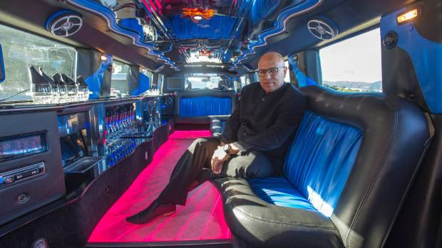 Limo Club 's David Oliver inside one of their two Hummer limos