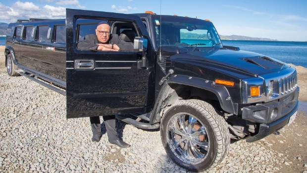 Limo Club's David Oliver with one of the firm's two Hummer limousines.