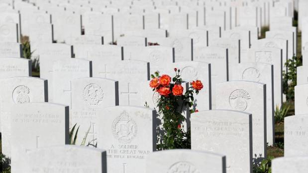 Flowers bloom amongst the graves of soldiers on the 100th anniversary of the battle of Passchendaele at Tyne Cot ...