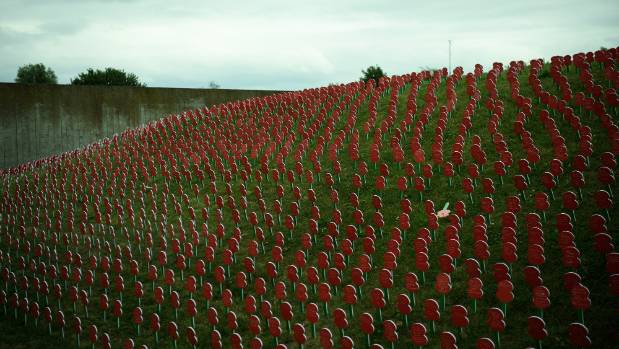 Poppies with personalised messages from members of the British public are seen at the Tyne Cot Cemetery on July 29, 2017 ...