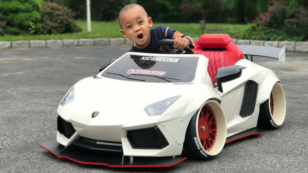 This young guy seems pretty happy with Lamborghini Aventador styled toy car from Kidstance.
