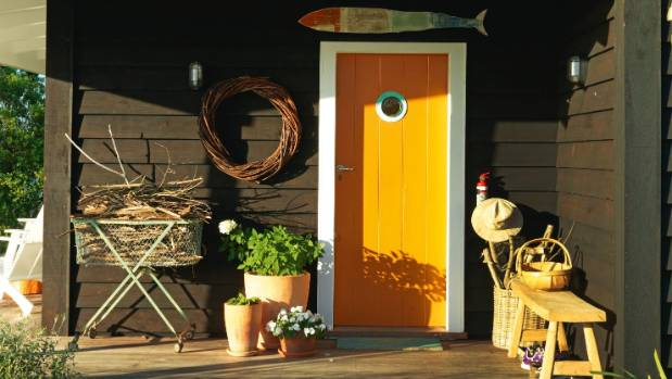 Karen Warman suggests painting the front door a bright colour is a good alternative to painting the entire exterior.