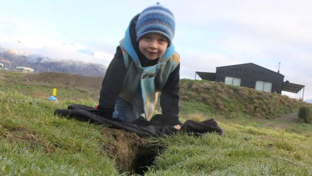 Pisa Moorings toddler Lochie, 3, has to watch his step on public land beside Lake Dunstan. The land is overrun with ...