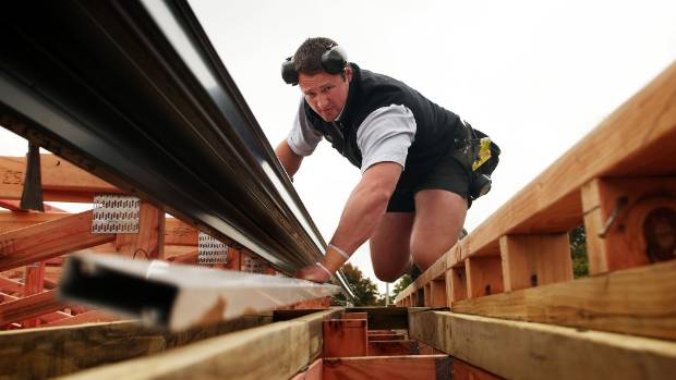 Tom Walsh works as a builder in Christchurch during the New Zealand summer.