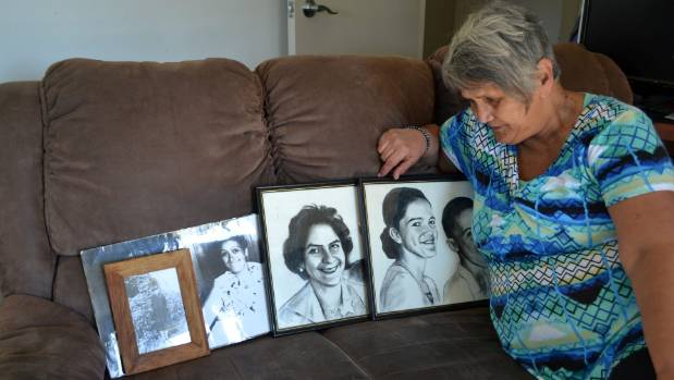 Sabrina Nathan-Kidwell looks at her family members that were killed, from left, her great-grandmother Beryl Abraham, ...