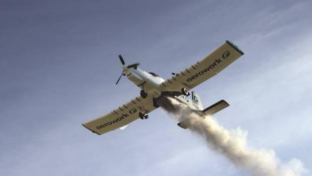A Ravensdown topdressing plane delivering fertiliser.