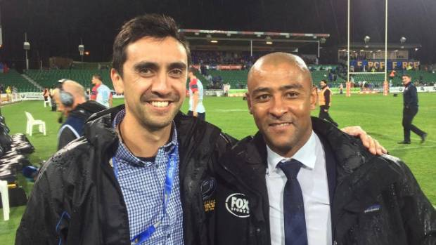 Tane Eunson, pictured here with former Wallaby George Gregan. In his role as a sideline doctor, Eunson will assess ...