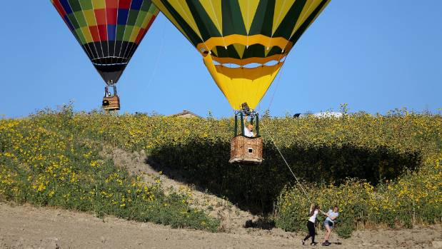Women tow their hot air balloon during a hot air ballooning event in Todi, Italy.