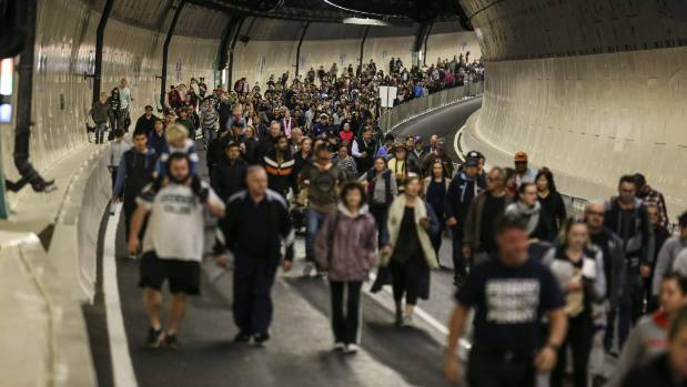 People walk through Auckland's Waterview Tunnel Connection on opening day, June 18, 2017.