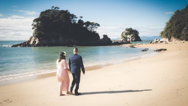 Kimberley Little and her husband in Kaiteriteri earlier this year.