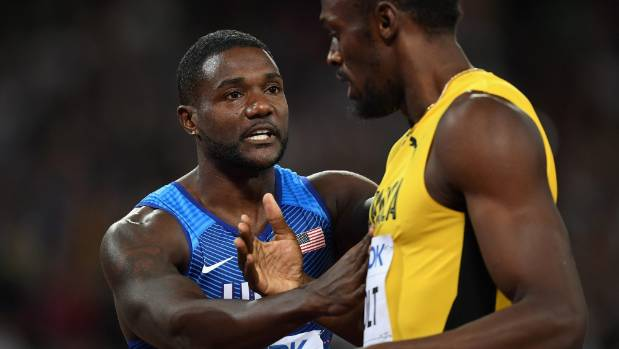 Usain Bolt hugs Justin Gatlin after the American won the 100m final at the World Athletics Championships in London.