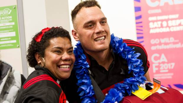 A Crusaders fan snaps a picture with outside back Israel Dagg.