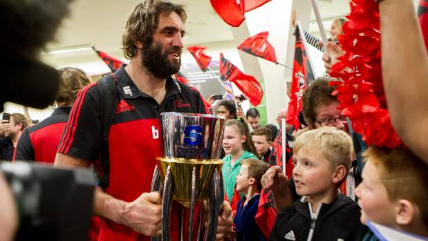 Crusaders captain Sam Whitelock was the first to emerge with the Super Rugby trophy.