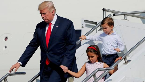 US President Donald Trump, with his grandchildren Arabella Kushner and Joseph Kushner, arrive for a summer holiday at ...