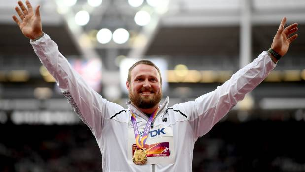 New Zealand's Tom Walsh won an historic world shot put title in London with a major groin tear.