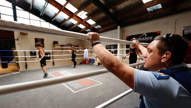 Nelson Police Community Constable Jason Rangi watches boys train at Victory Boxing.