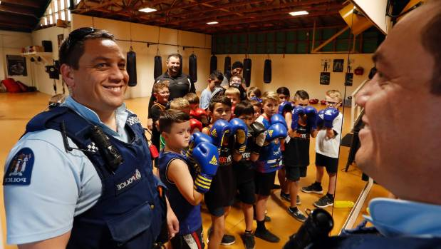 Nelson Police Community Constable Jason Rangi with leaders and boys at Victory Boxing.