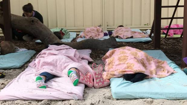 Kids at Little Learners in Perth, Australia, take their naps outside.