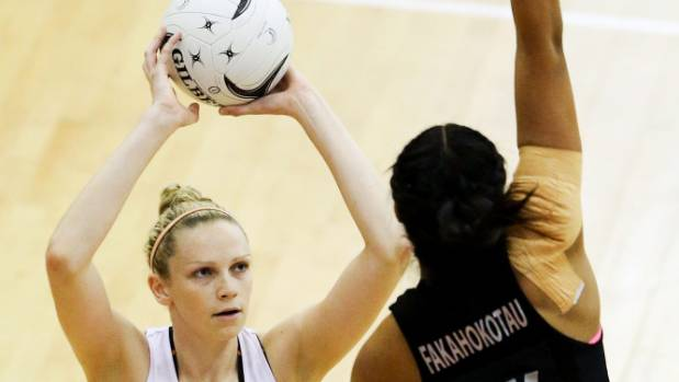 England shooter Jo Harten, pictured shooting over Silver Ferns defender Temalisi Fakahokotau in Palmerston North in October.