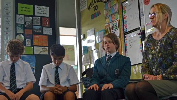 Teacher Nicola Hackett, right, leads a mindfulness session.