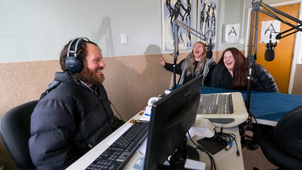 Audio engineer Chris Foreman in the studio with Iyarna Schuler, 18, and Adalee Forbes, 17.