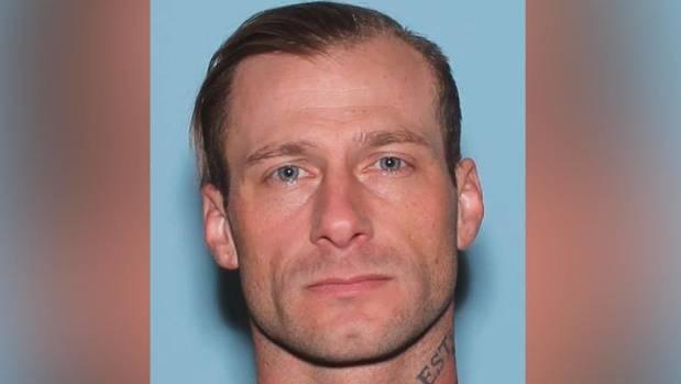 Police mugshot of Instagram model turned fugitive alleged bank robber David Byers.