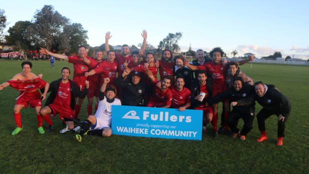 Waiheke United AFC celebrate their 7-1 win over Te Atatu on August 5 and their promotion for next season.