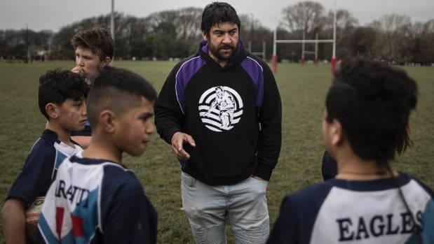 New Southland Rams rugby league coach Te Iwi Wairau coaching school kids in Hagley Park.